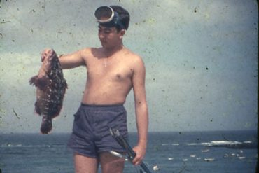 Juan Andres Melián tras pescar un buen abade. septiembre 1954-colecc. Juan Melián