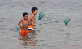 La alegría de los jovenes pescadores