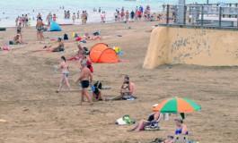Gente en la playa.