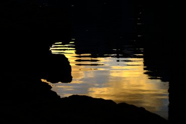 Un charco al amanecer